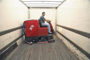 FactoryCat XR cleaning a trailer while on loading dock. Learn More